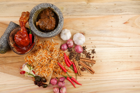 Nasi Briyani is a wholesome rice-based dish prepared with spices, rice, meat and vegetables. Foto de archivo