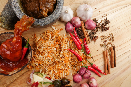 Nasi Briyani is a wholesome rice-based dish prepared with spices, rice, meat and vegetables. Stockfoto