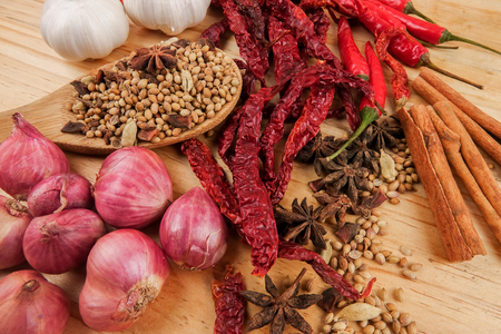 Mixture of beautiful spices and herbs on a wooden table Stock Photo