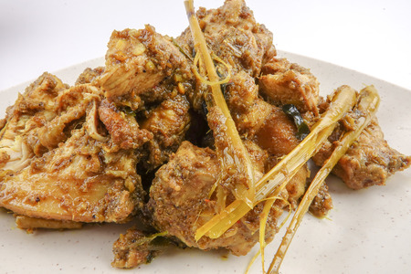 curry chicken rendang cooked in indian style with spicy sauce and chilli Foto de archivo