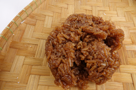 Asian confection, sweet glutinous rice  with brown sugar  or locally known as wajik in a white background 版權商用圖片
