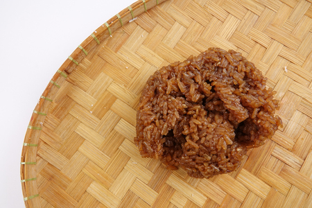 Asian confection, sweet glutinous rice  with brown sugar  or locally known as wajik in a white background Stock Photo