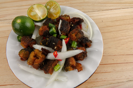 Deep fried eel with chilis,onions and lime.