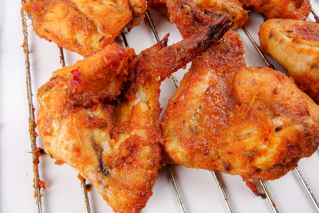 Roasted Chicken Wings isolated on white.