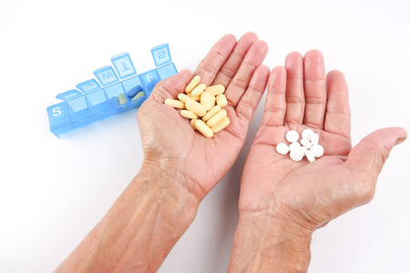 Close up of senior man taking medicines. Horizontal shape, high angle view, Selective focus