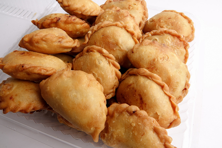 Curry Puffs (Epok-Epok  Karipap Pusing) - Deep Fried Malaysian, Singaporean, and Thai snack filled with curried meat andor vegetables. Stock Photo