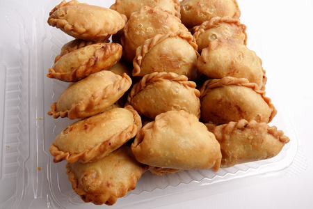 Curry Puffs (Epok-Epok / Karipap Pusing) - Deep Fried Malaysian, Singaporean, and Thai snack filled with curried meat and/or vegetables.