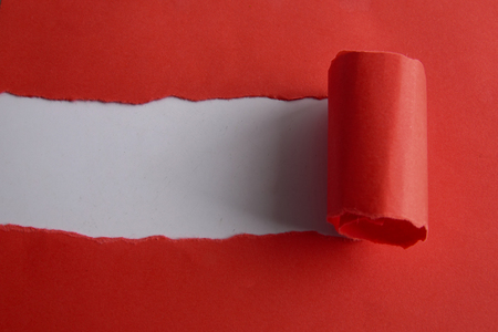 Red torn paper over white background. Copy space Banque d'images - 101825754