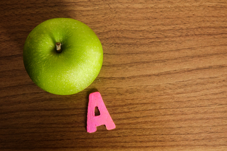 A green apple with alphabet A