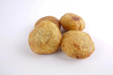 Asian/Malay traditional food - Cucur Badak, sweet potato with coconut filling ball. Stock Photo