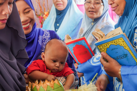 KUALA LUMPUR, 4 AUGUST 2018. Unidentify women at Quran recite ceremony for newborn Allah's blesssing in Malaysia. Éditoriale
