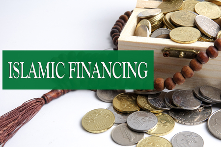 Coins in the wooden box and rosary. Islamic financebanking concept