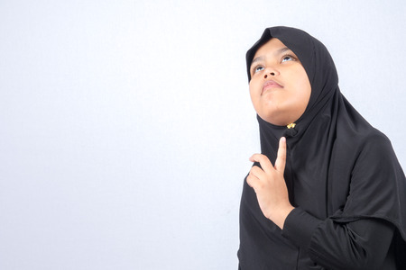Potrait of young asian muslim boygirl isolated on white background.