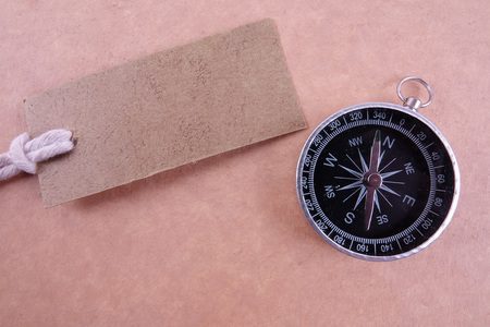 BUSINESS CONCEPT with brown tag and compass. Copy space Stock Photo
