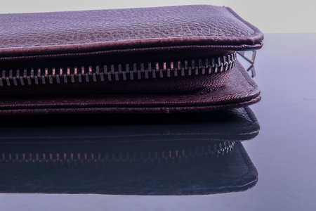 A brown mens leather wallet with reflection. Stock Photo
