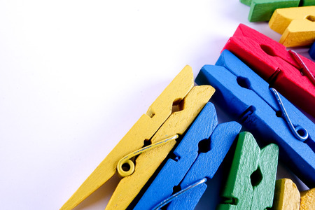 Colorful clothespins isolated on a white background. Stock Photo