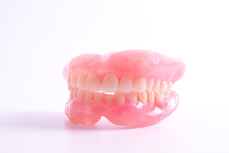 A set of dentures isolated on a white background. Archivio Fotografico