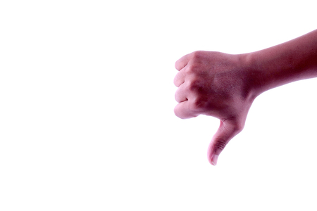 Hand with thumb down gesture isolated on white Фото со стока