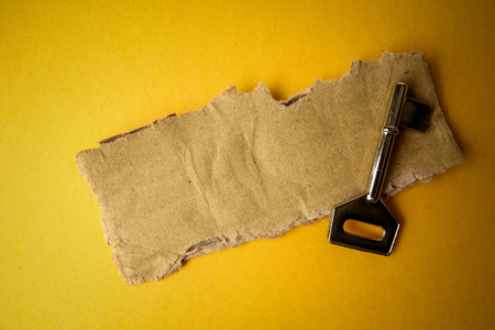 SUCCESS CONCEPTUAL with rustic  brown board and key.