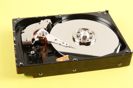 Hard disk drive (HDD) isolated on a yellow background