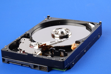 Hard disk drive (HDD) isolated on a blue background