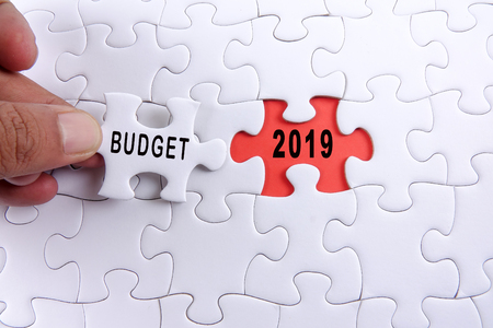 Business concept: 2019 BUDGET word on a jigsaw puzzle background. Фото со стока - 111743329