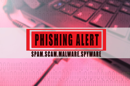 PHISHING ALERT SCAM CONCEPTUAL with laptop background. 版權商用圖片