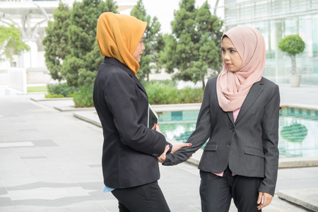 Business, people, crisis and confrontation concept; Two ladies seriously argued at outdoor. Banque d'images