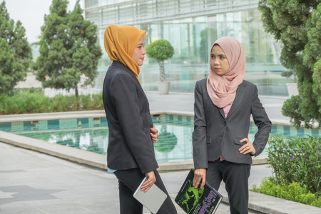 Business, people, crisis and confrontation concept; Two ladies seriously argued at outdoor.