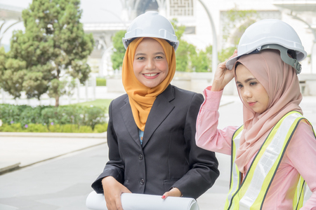 Professional woman engineers are discussing on construction at outdoor. Stock fotó
