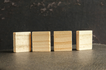 Blank wood  pieces isolated on grunge black background.