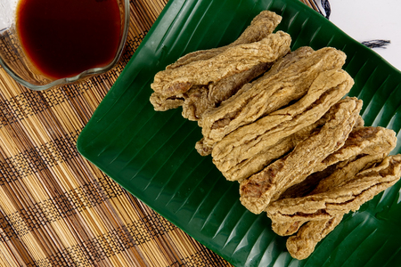 Malaysian fried fish snacks called Keropok Lekor.