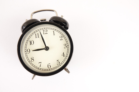 Time Punctuality Concept with black alarm clock.