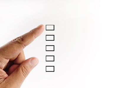 Finger ponting at checkbox isolated on white. Reklamní fotografie