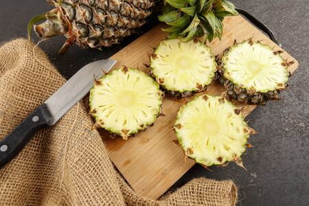 Cuts of pineapples on a chopping board. Stockfoto