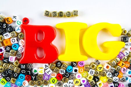 Word quotes of  Dream Big made from plastic alphabets over white background. Stockfoto