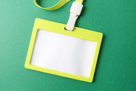 Empty ID card isolated on green background.