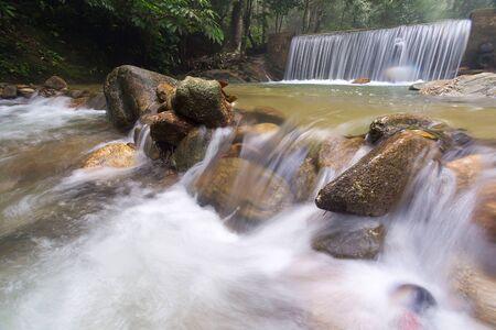 Waterfall/stream in a deep rain forest. Reklamní fotografie - 148815154