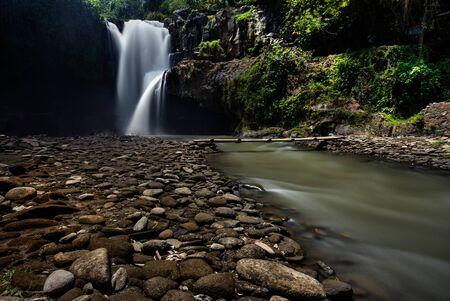 Waterfall/stream in a deep rain forest. Reklamní fotografie - 148815014