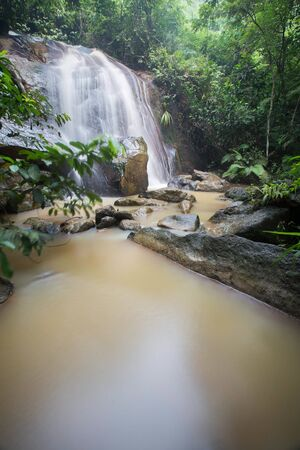 Waterfall/stream in a deep rain forest. Reklamní fotografie - 148815037