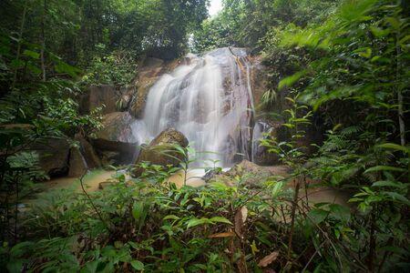 Waterfall/stream in a deep rain forest. Reklamní fotografie - 148815038