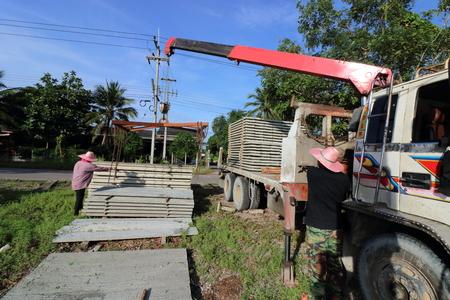 maneuverable: Worker controls of lifting crane in crane truck