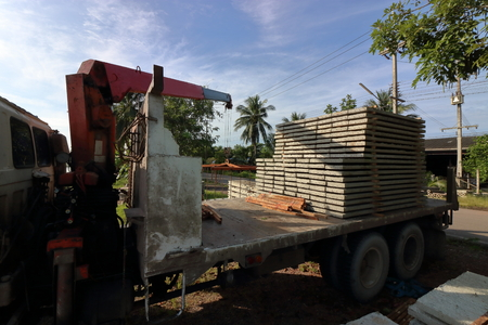 maneuverable: Stack of prestressed concrete slabs loaded on truck for construction Stock Photo