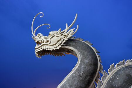 Chinese dragon on blue sky after sunset