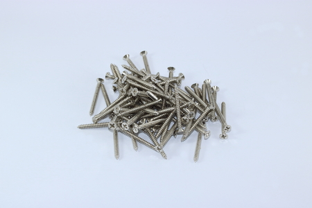 A pile of self tapping screws isolated on white background