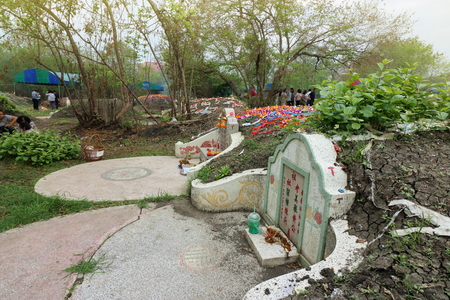 Ratchaburi, Thailand - April 4, 2017 : The graveyard at Qingming Festival at Jing Gung Cemetery.