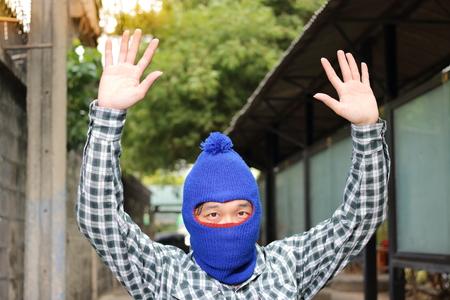Close up thief stop and put hands up. Catch burglar concept