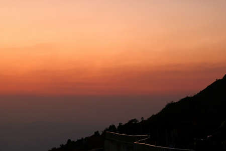 Beautiful twilight sunset and layers of silhouettes mountain in Chiang Mai , Thailand