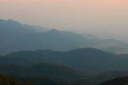 smoky mountains: Beautiful twilight layers of silhouettes mountain in Chiang Mai , Thailand