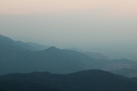 overlook: Beautiful twilight layers of silhouettes mountain in Doi inthanon , Chiang Mai , Thailand